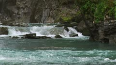 Green Water Creek Plunging through Rocky Steep Canyon Stock Footage