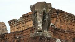 Elephant statue atop Pre Rup Stock Footage