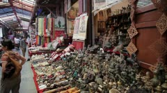 Vendors display crafts at a street market Stock Footage