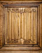 old door of wood with patterns carved on it. - stock photo