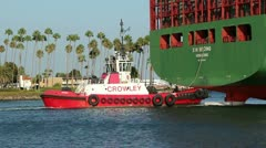 Tugboat  Provides Steerage For Container Ship Stock Footage