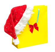Yellow packet with santa hat Stock Photos