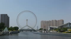 Tianjin Skyline in China, Tianjin Eye and Monument Diversion Project, timelapse Stock Footage