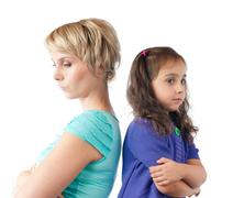 sad mother and daughter back to back - stock photo