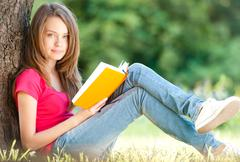 Happy young student girl with book Stock Photos