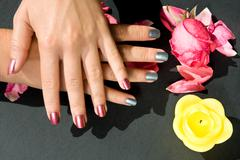 woman manicure arranged with rose - stock photo