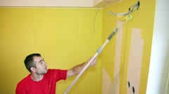 Painting the Wall in Yellow Stock Footage