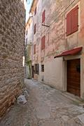 Stock Photo of Narrow stonepaved street in Bale
