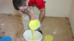 Painter Pouring Yellow Paint - Montage Stock Footage