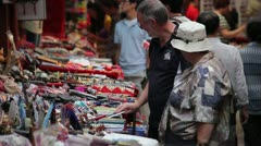 Tourists in street market Stock Footage