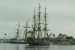 HMS Bounty preparing to leave dock and enter channel Stock Footage