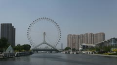 Tianjin Skyline in China, Tianjin Eye and Monument of Diversion, time lapse Stock Footage
