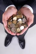Stock Photo of coins in hand
