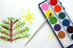 Children drawing and watercolor paints Stock Photos