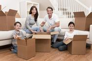 Stock Photo of family unpacking boxes moving house