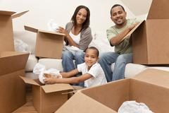 African american family unpacking boxes moving house Stock Photos