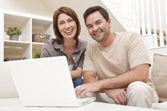 happy man woman couple using laptop computer at home - stock photo