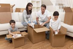 Family unpacking boxes moving house Stock Photos
