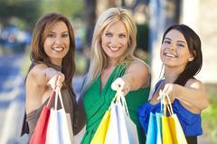 Three beautiful women with fashion shopping bags Stock Photos