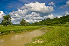 River Mirna after the rain with the clouds Stock Photos
