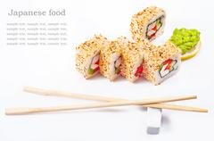 sushi roll with sesame, sweet pepper, cucumber and wasabi - stock photo