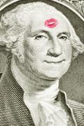 Lipstick kiss on one dollar bill Stock Photos