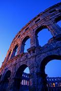 Roman amphitheatre in the sunset Stock Photos