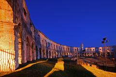 Grandstands of the Roman amphitheatre in Pula - stock photo