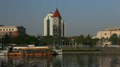 Tianjin Skyline in China, Bell Cock Tower in front of Bei'An Bridge Stock Footage