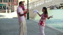 Rich couple fighting by the canal in Venice, slow motion, crane shot HD - stock footage