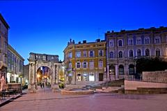 Square Portarata in Pula with the Arch of the Sergii Stock Photos