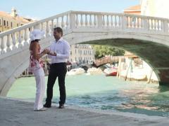 Man proposing marriage to surprised woman in Venice, crane shot NTSC Stock Footage