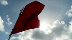 Red Flag w:Sunburst in Strong Wind Stock Footage