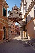 Baroque archway Balbi and the street in Rovinj - stock photo