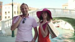 Stock Video Footage of Happy rich couple with shoping bags in Venice, crane shot HD