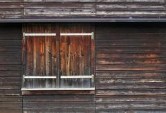 Stock Photo of wooden facade with shutter