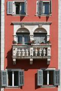 Romantic balcony on the medival building - stock photo