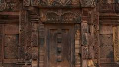 Tilt up of ornate temple door at Banteay Srei Stock Footage