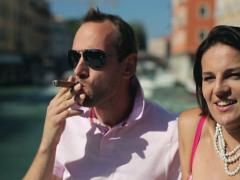 Happy rich couple relaxing and talking in Venice, crane shot NTSC Stock Footage