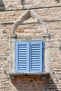 Venetian gothic window with blue shutters Stock Photos