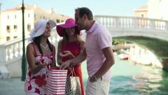 Stock Video Footage of Rich, wealthy friends with shoping bags meeting in Venice, crane shot HD