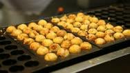 Stock Video Footage of Close Up Cooking Meatballs Japan Street Food Dumpling Fried Snack Takoyaki Dish