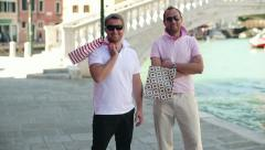 Happy rich male friends with shoping bags in Venice HD - stock footage