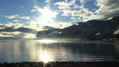 Cruise Ship in Whittier, Alaska - Dazzling Sun Mist Pan Stock Footage