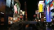 Stock Video Footage of Establishing Shot Busy Shopping Street Popular Market Area Osaka Night Lights