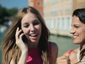 Happy female friends talking on cellphone in Venice, crane shot NTSC Stock Footage