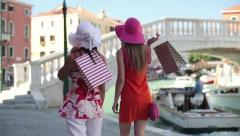 Women with shopping bags walking in Venice, slow motion, crane shot HD Stock Footage