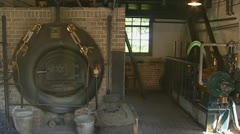 Stock Video Footage of 1920's laundry steam machine in barn pan