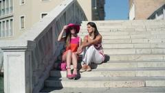 Stock Video Footage of Rich, stylish girlfriends chatting on stairs in Venice, crane shot HD