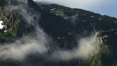 Swirling Updraft Mists over Craggy Cliffs Stock Footage